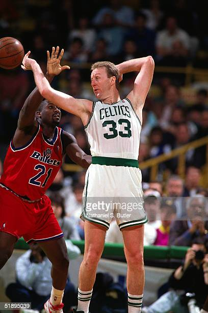 Larry Bird of the Boston Celtics throws a blind backward pass out of the post against the Washington Bullets during an NBA game in 1987 at the Boston...