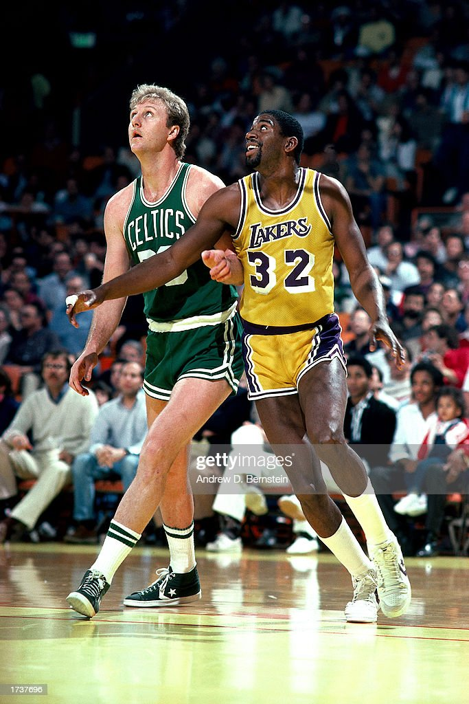 Larry Bird #33 of the Boston Celtics waits for a rebound against Magic Johnson of the Los Angeles Lakers at The Great Western Forum on January 1, 1986 in Los Angeles, California.