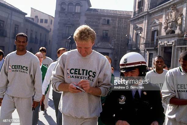 Larry Bird of the Boston Celtics walks to El Ayuntamiento Madrid's City Hall to meet Mayor Juan Barranco during the 1988 McDonald's Championships on...