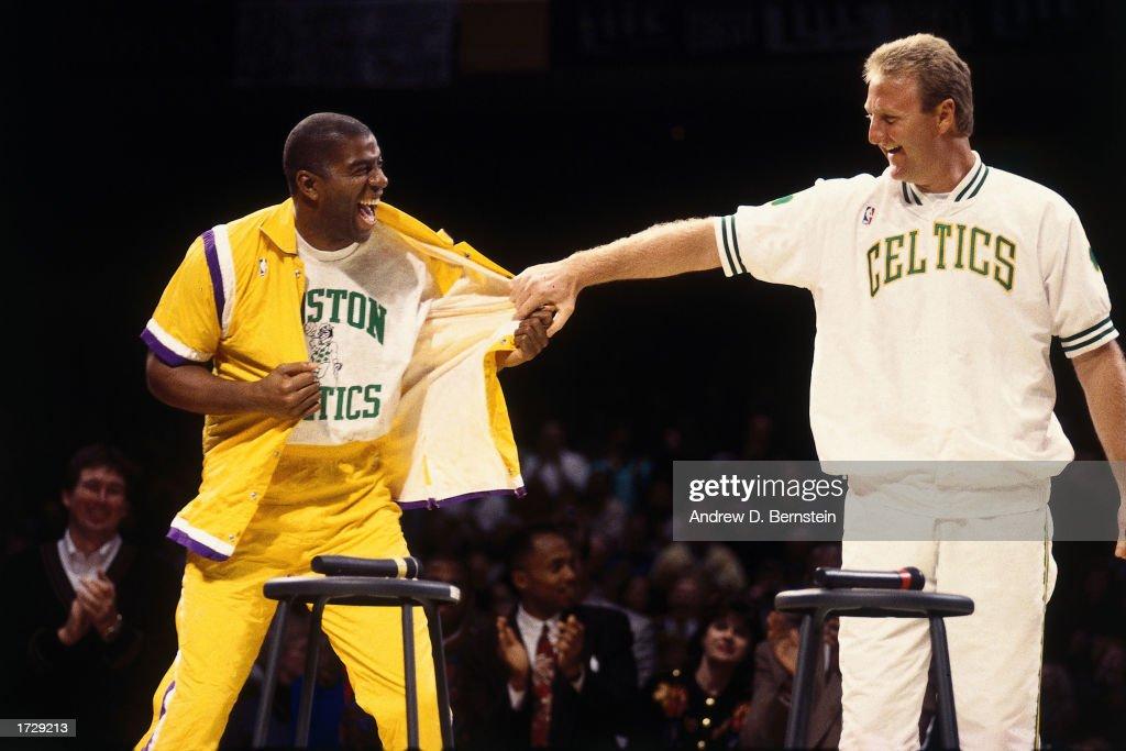 Larry Bird #33 of the Boston Celtics with Magic Johnson of the Los Angeles Lakers during Larry Bird Night at the Boston Garden on February 4, 1993 in Boston, Massachusetts.