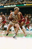 Larry Bird pivots past Rocket's Rodney McCray during third quarter action of game two of the NBA Championship at Boston Garden 5/29 Bird scored 31...