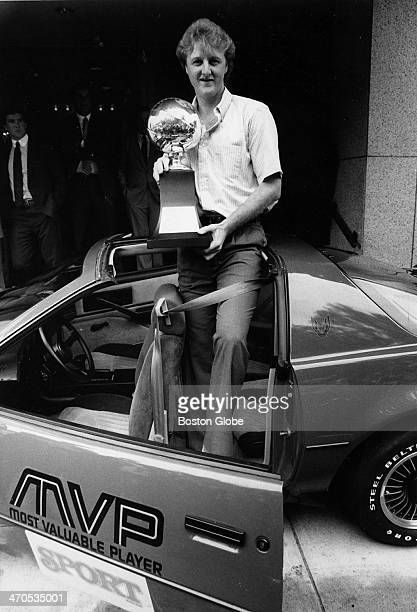 Larry Bird sits on the roof of the TransAm he won for being NBA playoff MVP June 19 1984