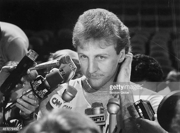 Larry Bird talks with the media