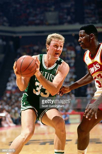 Larry Bird#33 of the Boston Celtics fakes a move against the Atlanta Hawks during an NBA game at the Omni circa 1986 in Atlanta Georgia NOTE TO USER...
