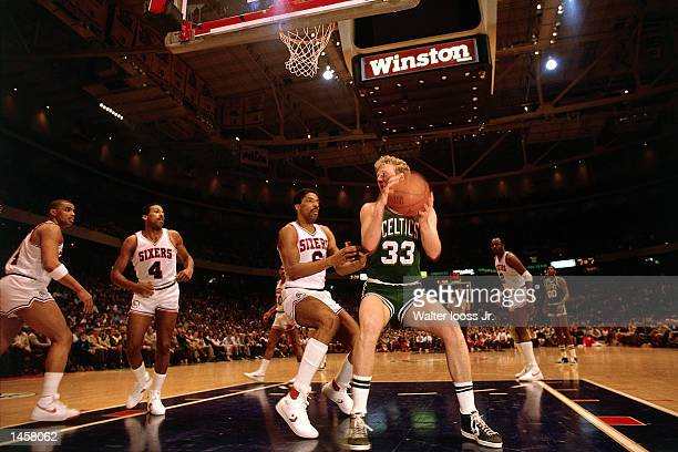 Larry Bird#33 of the Boston Celtics grabs a rebound in 1986 against the Philadelphia 76ers during the NBA game at The Spectrum in Philadelphia...