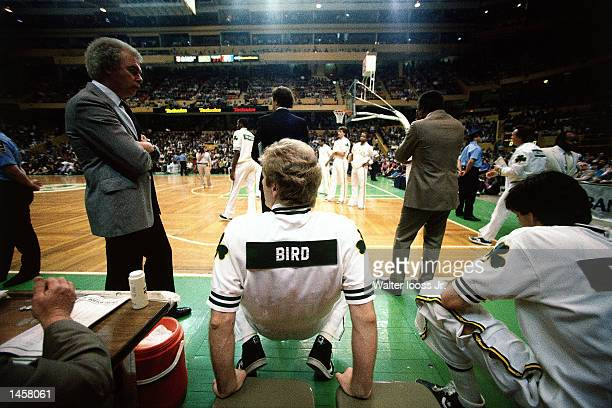 Larry Bird#33 of the Boston Celtics stretches his back in1990 during pregame warmups at The Boston Garden in Boston Massachusetts NOTE TO USER User...