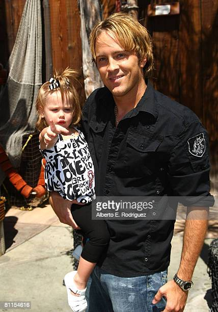 Larry Birkhead and daughter Dannielynn Birkhead arrive at the Launch celebration party for The Simpson's Ride at Universal Studios Hollywood on May...