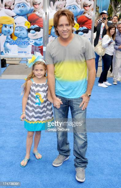 Larry Birkhead and daughter Dannielynn Birkhead arrive at the Los Angeles premiere of 'Smurfs 2' at Regency Village Theatre on July 28 2013 in...