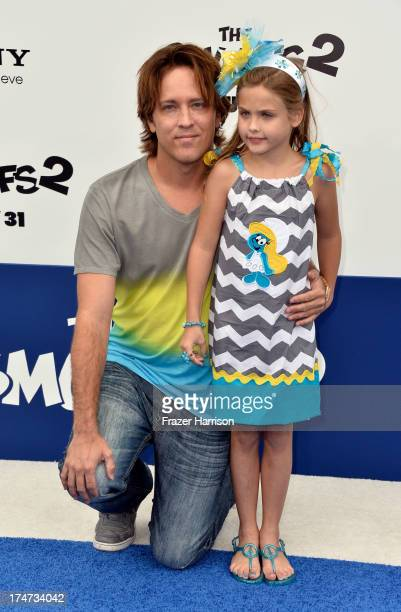 Larry Birkhead and daughter Dannielynn Birkhead attend the premiere of Columbia Pictures' 'Smurfs 2' at Regency Village Theatre on July 28 2013 in...