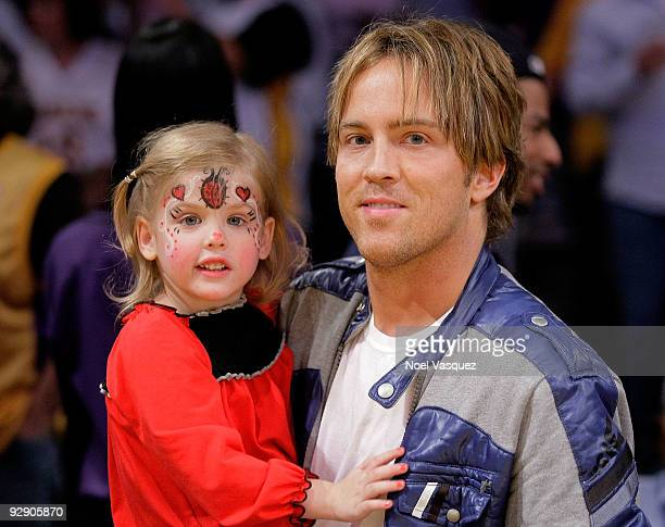 Larry Birkhead and his daughter Dannielynn Birkhead attend a game between the New Orleans Hornets and the Los Angeles Lakers at Staples Center on...