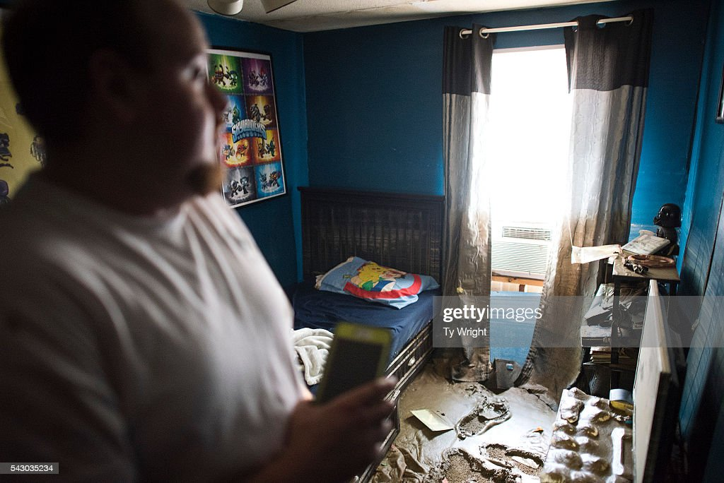 Larry Brooks looks at the damage done to his son's bedroom in his trailer which was destroyed by flood waters, June 25, 2016 in Elkview, West Virginia. Brooks said he lost about 95 percent of the personal belongings in his home. The flooding of the Elk River claimed the lives of at least 23 people in West Virginia.