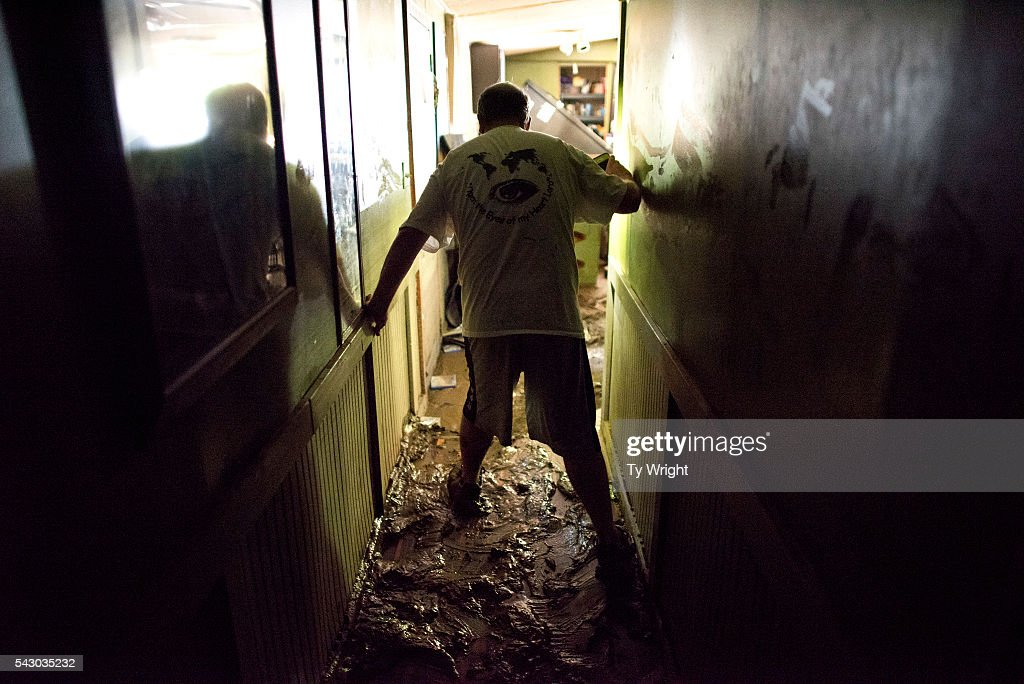 Larry Brooks walks down the hallway of his trailer on a mud covered floor which was destroyed by flood waters on June 25, 2016 in Elkview, West Virginia. Brooks said he lost about 95 percent of the personal belongings in his home. The flooding of the Elk River claimed the lives of at least 23 people in West Virginia.