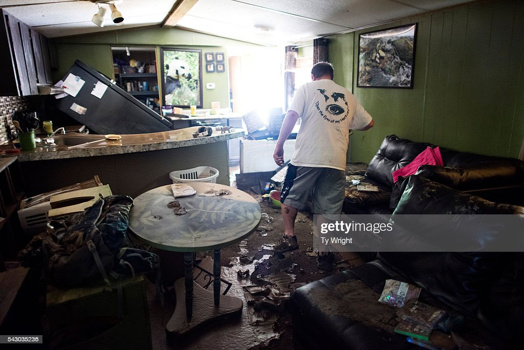 Larry Brooks walks through his trailer which was destroyed by flood waters, June 25, 2016 in Elkview, West Virginia. Brooks said he lost about 95 percent of the personal belongings in his home. The flooding of the Elk River claimed the lives of at least 23 people in West Virginia.