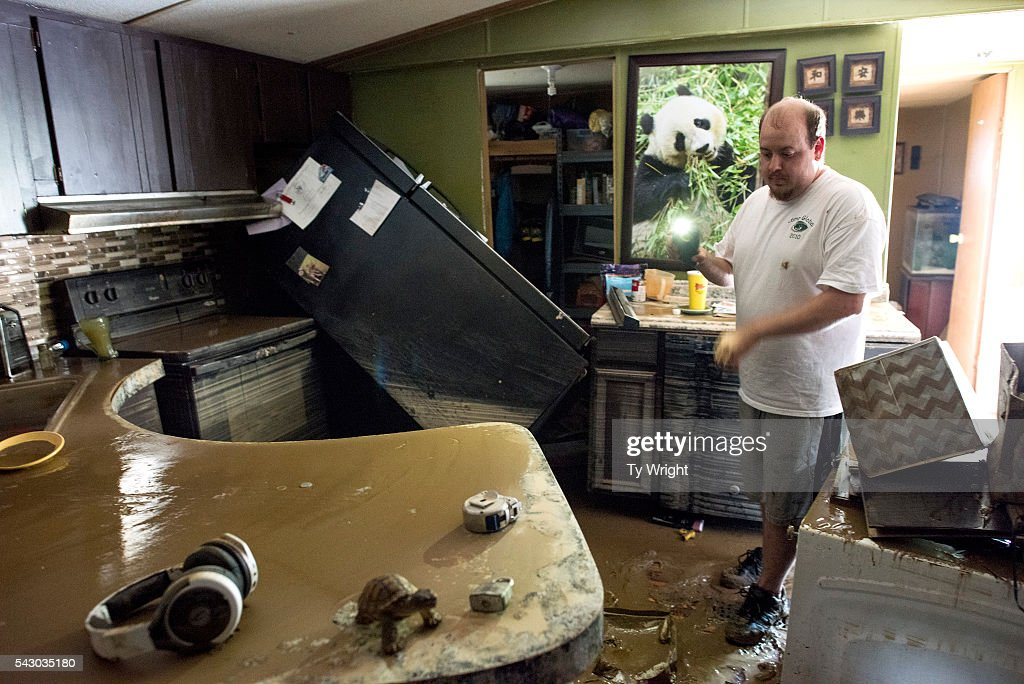 Larry Brooks walks through his trailer which was destroyed by flooding on June 25, 2016 in Elkview, West Virginia. Brooks said he lost about 95 percent of the personal belongings in his home. The flooding of the Elk River claimed the lives of at least 23 people in West Virginia.