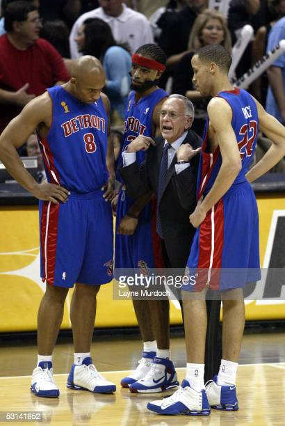 Larry Brown head coach of the Detroit Pistons talks to Darvin Ham Richard Hamilton and Tayshaun Prince during a game against the San Antonio Spurs in...