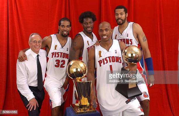 Larry Brown Richard Hamilton Ben Wallace Chauncey Billups and Rasheed Wallace of the Detroit Pistons pose for a portrait with the NBA Championship...