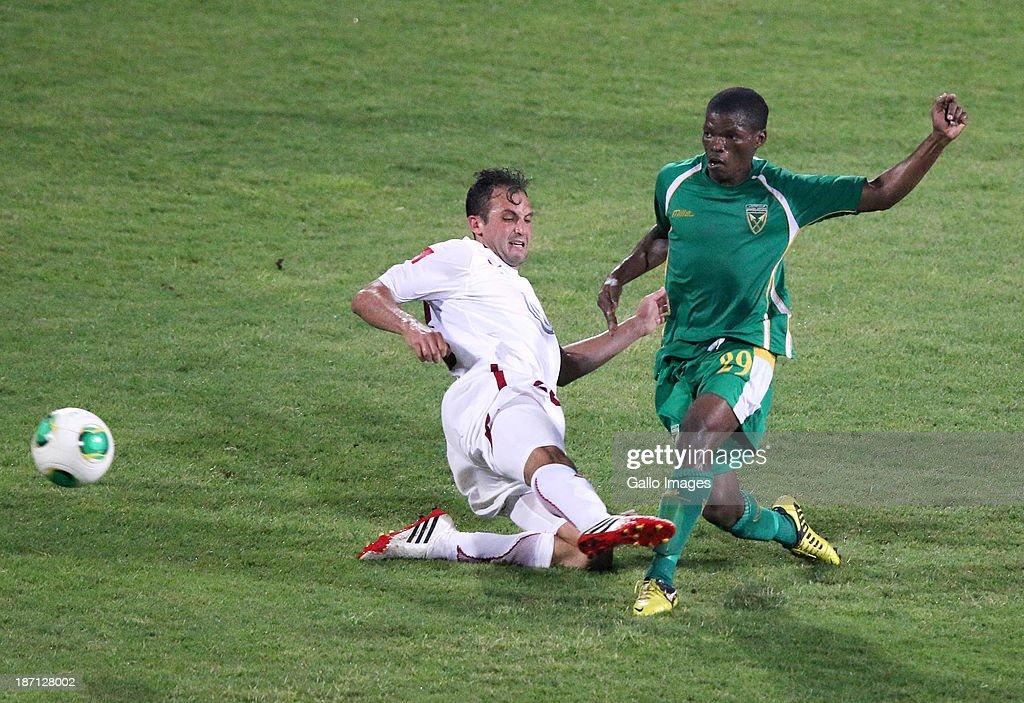 Larry Cohen of Moroka Swallows goes into challenge Litha Ngxabi of Golden Arrows during the Absa Premiership match between Golden Arrows and Moroka...