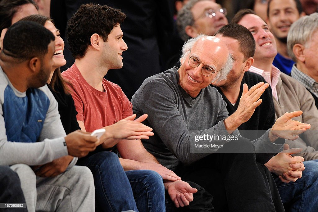<a gi-track='captionPersonalityLinkClicked' href=/galleries/search?phrase=Larry+David&family=editorial&specificpeople=125184 ng-click='$event.stopPropagation()'>Larry David</a> talks with <a gi-track='captionPersonalityLinkClicked' href=/galleries/search?phrase=Justin+Bartha&family=editorial&specificpeople=653334 ng-click='$event.stopPropagation()'>Justin Bartha</a> during the game between the New York Knicks and the San Antonio Spurs at Madison Square Garden on November 10, 2013 in New York City. The Spurs defeat the Knicks 120-89.