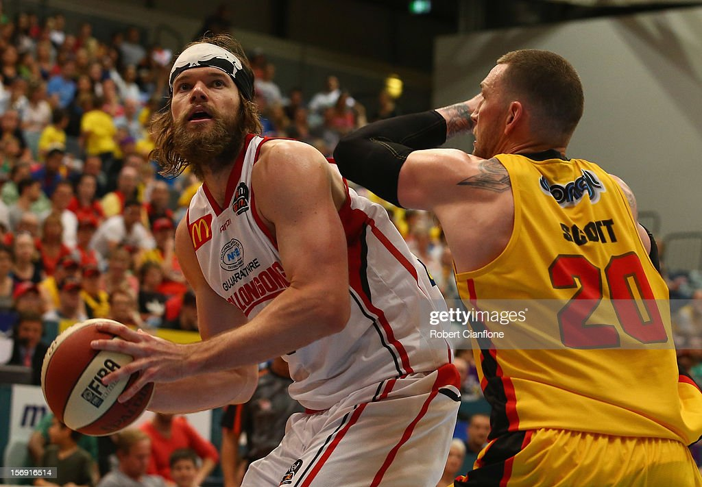 Larry Davidson of the Hawks looks to get the ball past Seth Scott of the Tigers during the round eight NBL match between the Melbourne Tigers and the Wollongong Hawks at State Netball Hockey Centre on November 25, 2012 in Melbourne, Australia.