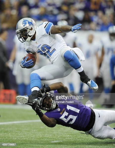 Larry Dean of the Minnesota Vikings tackles Jeremy Ross of the Detroit Lions during the first quarter of the game on December 29 2013 at Mall of...