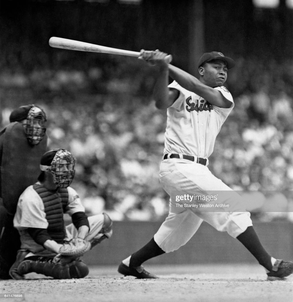 Larry Doby, centerfielder of the Cleveland Indians, hit a home run, during his second season in 1948.