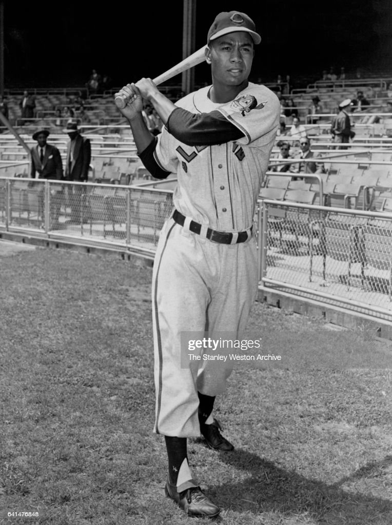 Larry Doby, centerfielder of the Cleveland Indians, poses for a portrait swinging his bat prior to a game in the year 1951.
