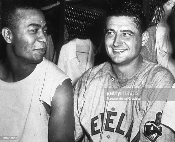 Larry Doby left and Early Wynn talk about their performances in the clubhouse after a game in Cleveland in 1950