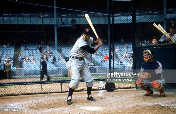 Larry Doby of the Cleveland Indians hits in the batting cage before an MLB game against the New York Yankees on May 11 1955 at Yankee Stadium in the...