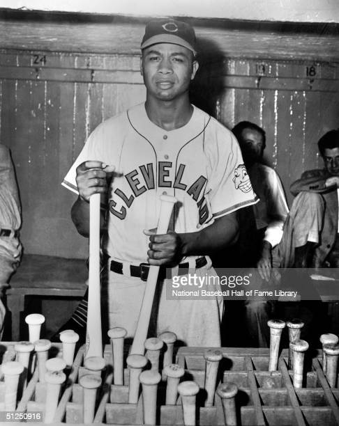 Larry Doby poses as he grabs a bat during a 1949 season game Larry Doby played for the Cleveland Indians from 19471955 then in 1958