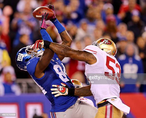 Larry Donnell of the New York Giants makes the catch for the game winning touchdown as NaVorro Bowman of the San Francisco 49ers defends in the...