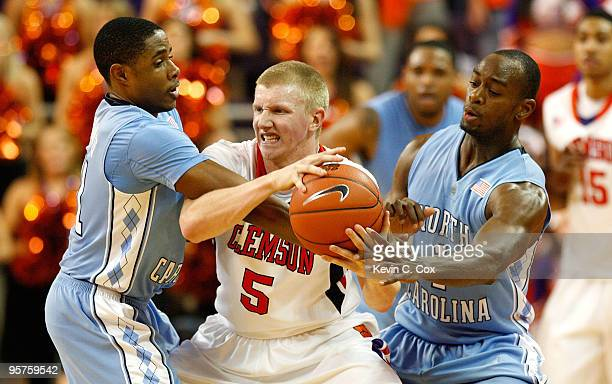 Larry Drew II and Marcus Ginyard of the North Carolina Tar Heels trap Tanner Smith of the Clemson Tigers at Littlejohn Coliseum on January 13 2010 in...