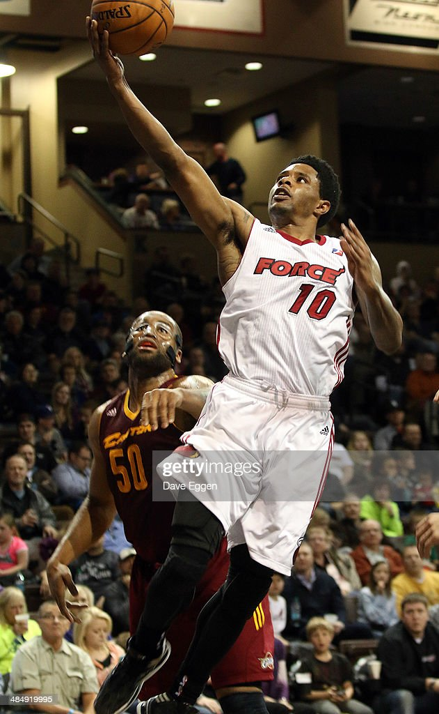 Larry Drew II from the Sioux Falls Skyforce lays the ball up for two past Arinze Onuaku from the Canton Charge in the second half of their NBA...