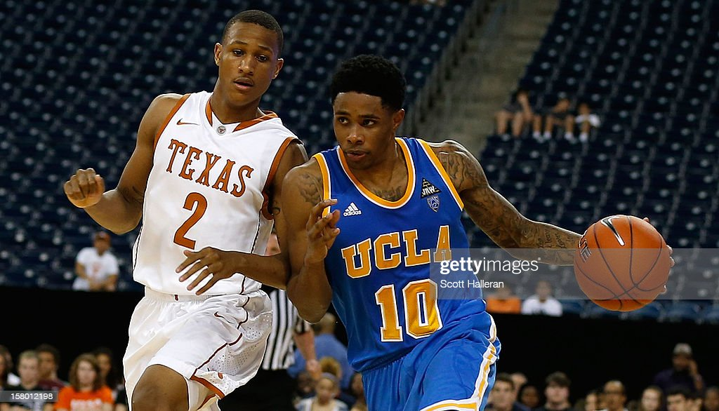 <a gi-track='captionPersonalityLinkClicked' href=/galleries/search?phrase=Larry+Drew+II&family=editorial&specificpeople=5088949 ng-click='$event.stopPropagation()'>Larry Drew II</a> #10 of the UCLA Bruins drives past Demarcus Holland #2 of the Texas Longhorns during the MD Anderson Proton Therapy Showcase at Reliant Stadium on December 8, 2012 in Houston, Texas.