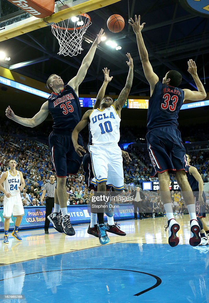 <a gi-track='captionPersonalityLinkClicked' href=/galleries/search?phrase=Larry+Drew+II&family=editorial&specificpeople=5088949 ng-click='$event.stopPropagation()'>Larry Drew II</a> #10 of the UCLA Bruins shoots between <a gi-track='captionPersonalityLinkClicked' href=/galleries/search?phrase=Kaleb+Tarczewski&family=editorial&specificpeople=8047518 ng-click='$event.stopPropagation()'>Kaleb Tarczewski</a> #35 and <a gi-track='captionPersonalityLinkClicked' href=/galleries/search?phrase=Grant+Jerrett&family=editorial&specificpeople=7887154 ng-click='$event.stopPropagation()'>Grant Jerrett</a> #33 of the Arizona Wildcats at Pauley Pavilion on March 2, 2013 in Los Angeles, California.