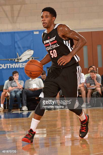 Larry Drew of the Miami Heat handles the ball against the Detroit Pistons during the Samsung NBA Summer League 2014 on July 8 2014 at Amway Center in...