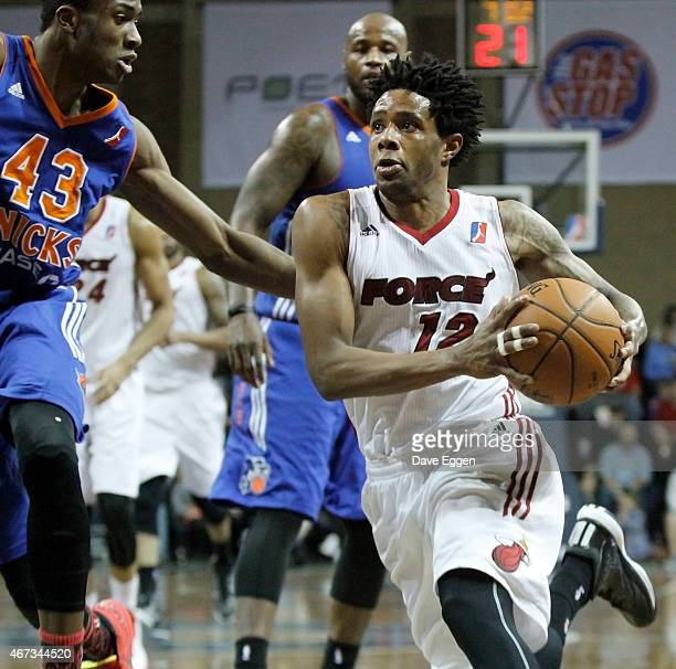Larry Drew of the Sioux Falls Skyforce drives to the basket against Thanasis Antetokounmpo of the Westchester Knicks in the second half of their NBA...