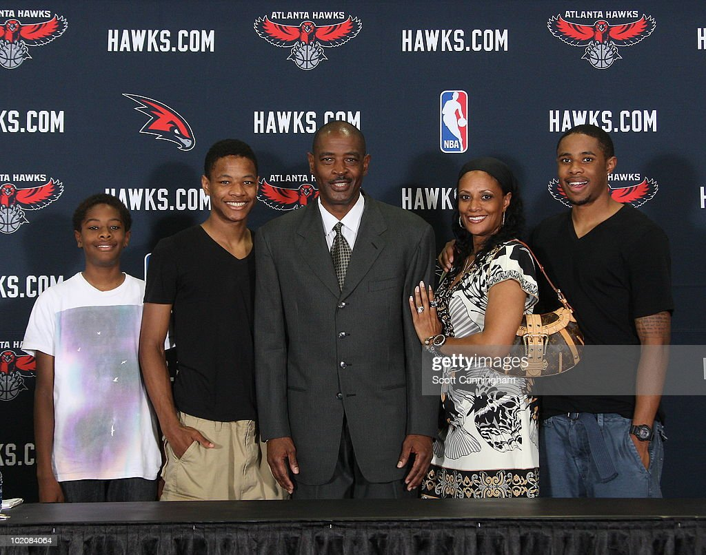 Larry Drew (C) poses with his family after being named the new head coach of the Atlanta Hawks on June 14, 2010 at Philips Arena in Atlanta, Georgia.