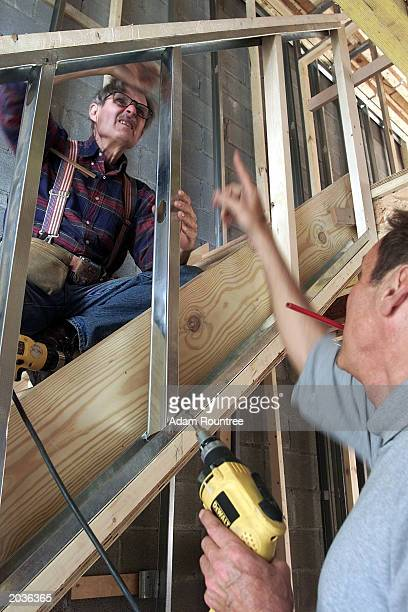 Larry Driskell and Carl Schuman volunteer to build a Habitat for Humanity house May 28 2003 in Bronx neighborhood of New York City Habitat for...