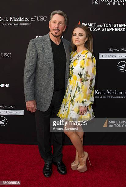 Larry Ellison and Nikita Kahn attend the 3rd Biennial Rebels with a Cause Fundraiser at Barker Hangar on May 11 2016 in Santa Monica California