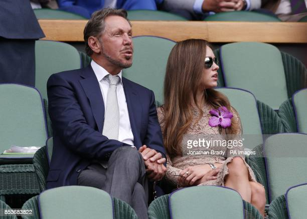 Larry Ellison and Nikita Kahn in the Royal Box on Centre Court during day fourteen of the Wimbledon Championships at the All England Lawn Tennis and...