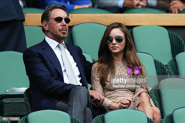 Larry Ellison and Nikita Kahn sit in the Royal Box on Centre Court before the Gentlemen's Singles Final match between Roger Federer of Switzerland...