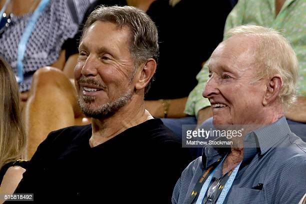 Larry Ellison and Rod Laver of Australia watch Novak Djokovic of Serbia play Philipp Kohlschreiber of Germany during the BNP Paribas Open at the...