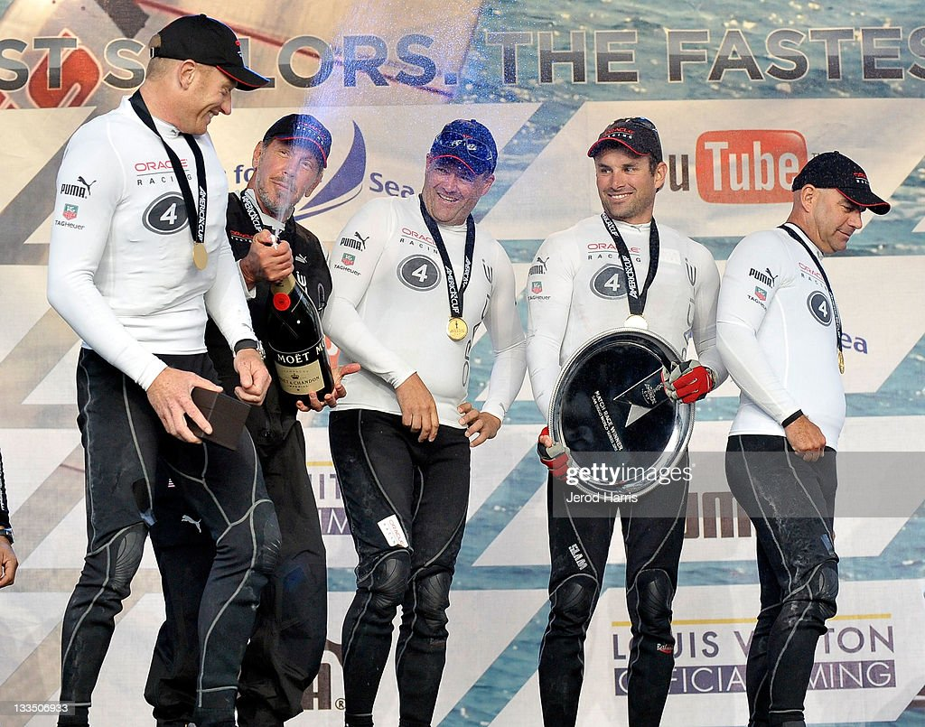 Larry Ellison (2nd from the left) and the crew of Oracle Racing celebrate their first place win of the America's Cup San Diego Match Racing Championship with a traditional jerobaum of Moet & Chandon champagne on November 19, 2011 in San Diego, California.
