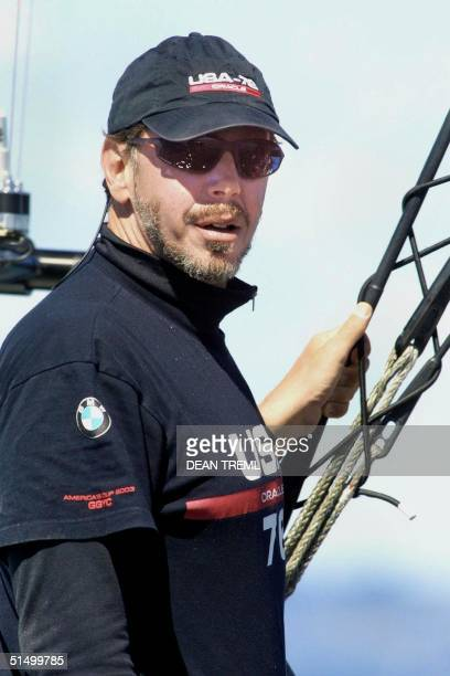 Larry Ellison chairman and CEO of Oracle Corporation and parttime helmsman of Oracle BMW racing syndicate stands at the back of his yacht USA76 after...