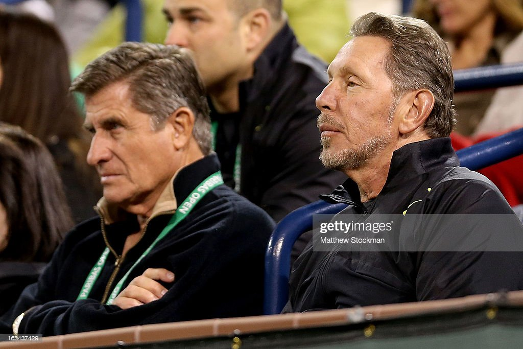 Larry Ellison, tournament owner and CEO of Oracle, watches Ryan Harrison play Rafael Nadal of Spain during the BNP Paribas Open at the Indian Wells Tennis Garden on March 9, 2013 in Indian Wells, California.