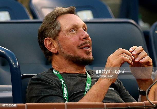 Larry Ellison watches as Lleyton Hewitt of Australia plays Matthew Ebden of Australia during the BNP Paribas Open at Indian Wells Tennis Garden on...