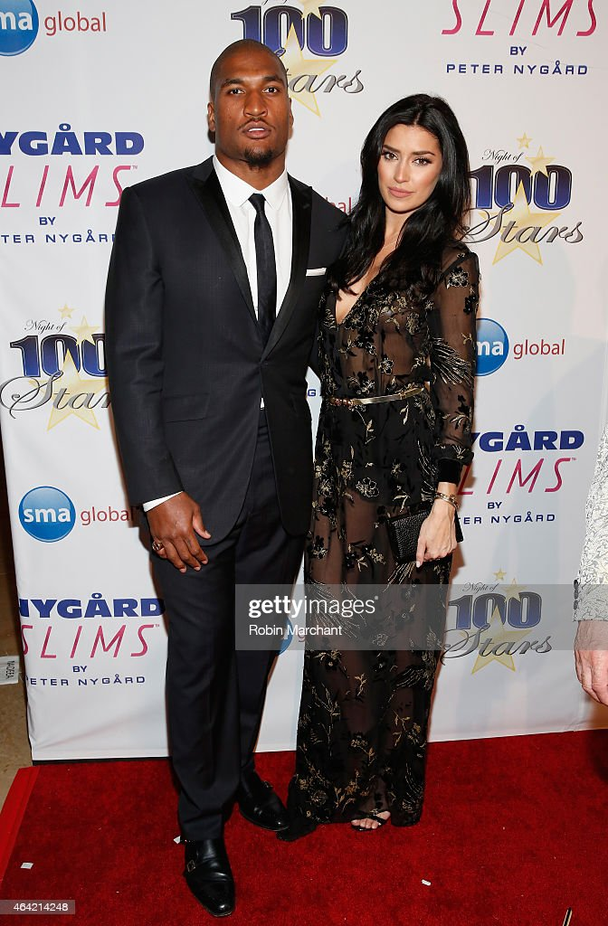 Larry English and Nicole Williams attend the Norby Walters 25th Annual Night of 100 Stars Oscar Viewing Gala at The Beverly Hilton Hotel on February...