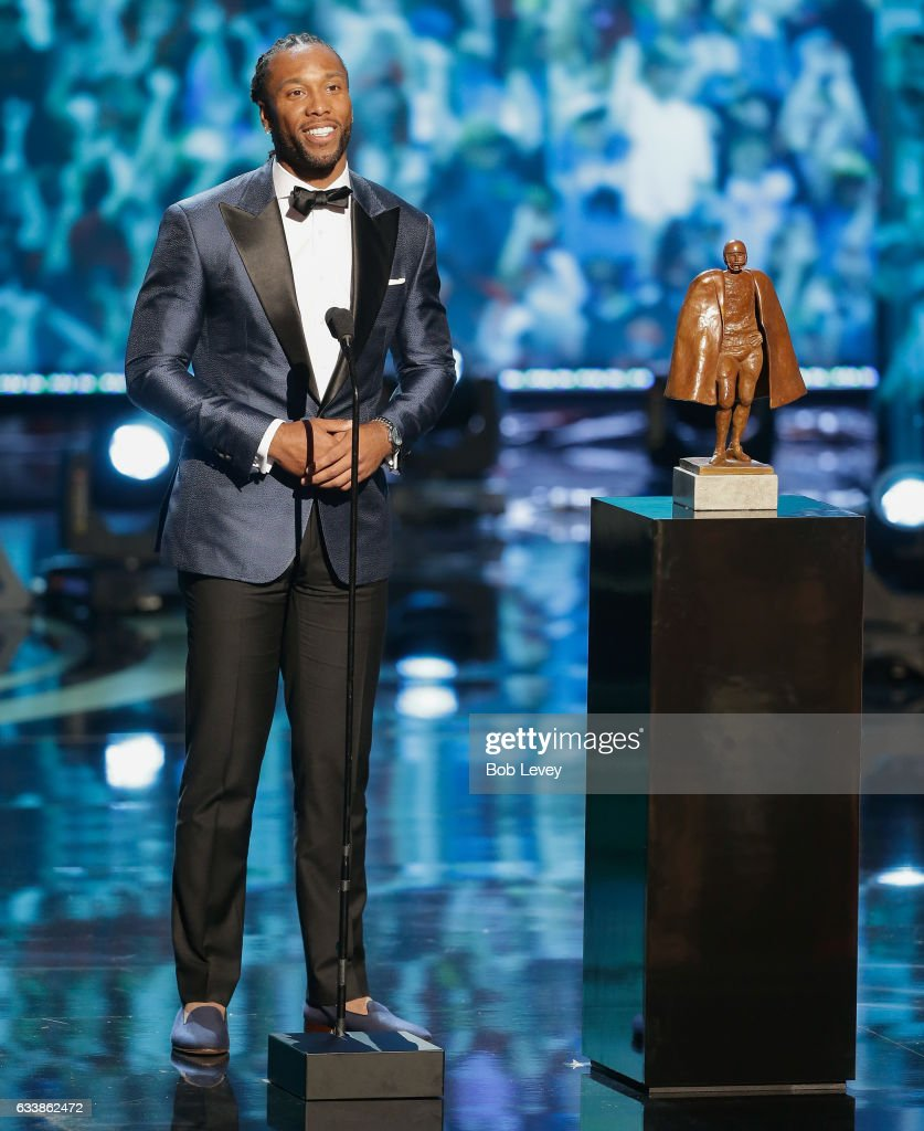 Larry Fitzgerald accepts the Walter Payton NFL Man of the Year presented by Nationwide at Wortham Theater Center on February 4, 2017 in Houston, Texas. Eli Manning also received the award this year.
