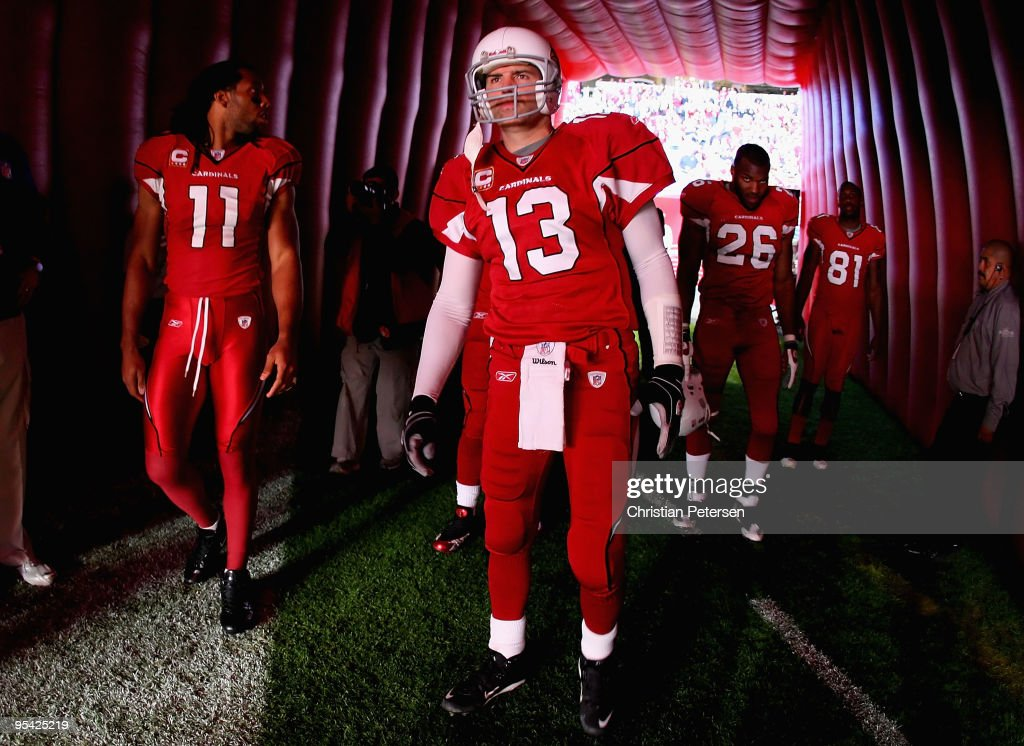 Larry Fitzgerald Kurt Warner Beanie Wells and Anquan Boldin of the Arizona Cardinals prepare to take the field before the NFL game against the St...
