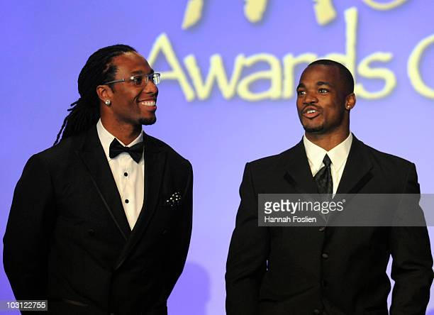Larry Fitzgerald of the Arizona Cardinals and Adrian Peterson of the Minnesota Vikings honors Muhammed Ali at the 2010 Starkey Hearing Foundation...